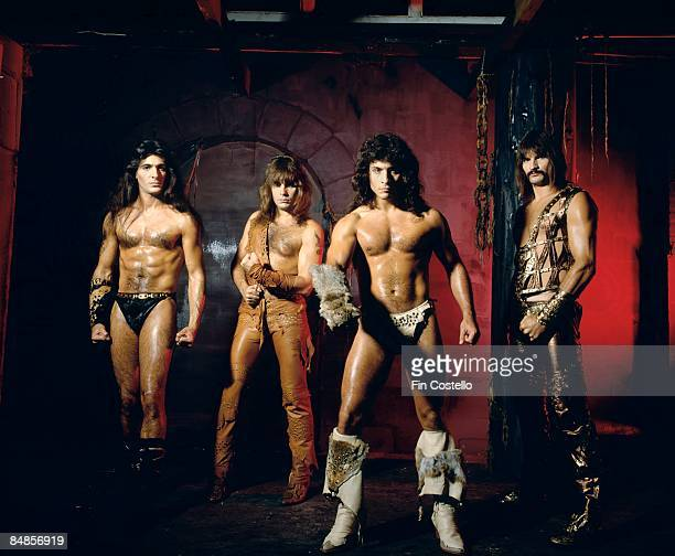 Photo of Scott COLUMBUS and Ross FRIEDMAN and MANOWAR and Joey DeMAIO and Eric ADAMS Posed studio group portrait full length barechested LR Joey...