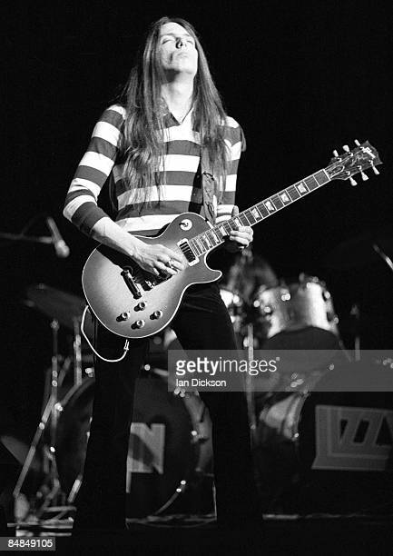 Photo of Scott GORHAM and THIN LIZZY Scott Gorham performing live onstage playing Gibson Les Paul Deluxe guitar