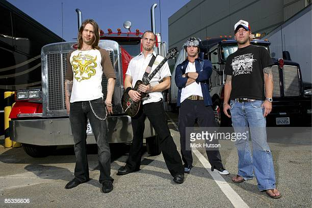 Photo of Scott PHILLIPS and Brian MARSHALL and Mark TREMONTI and Myles KENNEDY and ALTER BRIDGE Posed group portrait truck guitar LR Myles Kennedy...