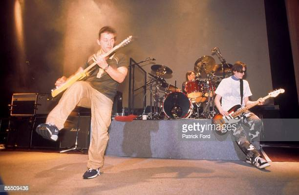 Photo of Sean MOORE and MANIC STREET PREACHERS and James Dean BRADFIELD and Nicky WIRE LR James Dean Bradfield Sean Moore Nicky Wire performing live...