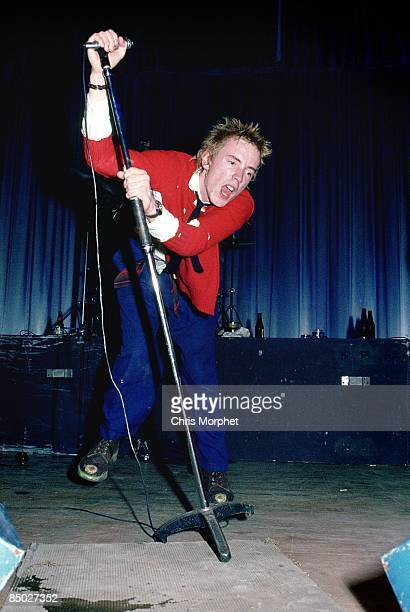 Photo of SEX PISTOLS Johnny Rotten performing live onstage at Dunstable's Queensway Hall