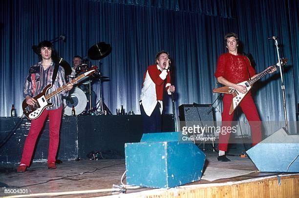Photo of SEX PISTOLS LR Glen Matlock Paul Cook Johnny Rotten Steve Jones performing live onstage at Dunstable's Queensway Hall