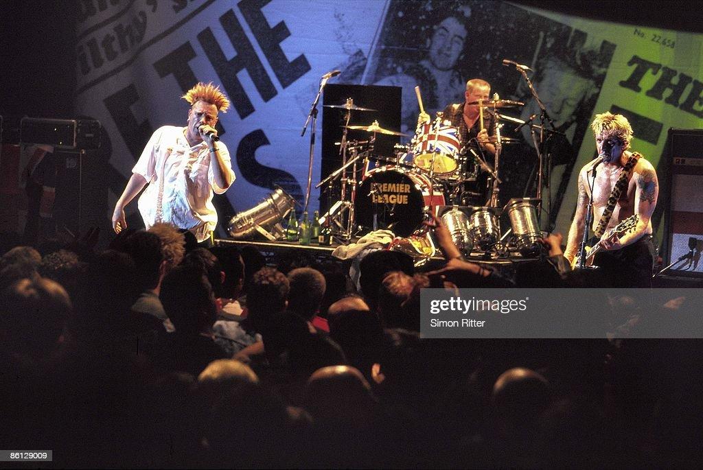 Johnny Rotten (John Lydon), Paul Cook (drums), Steve Jones (guitar) performing live onstage