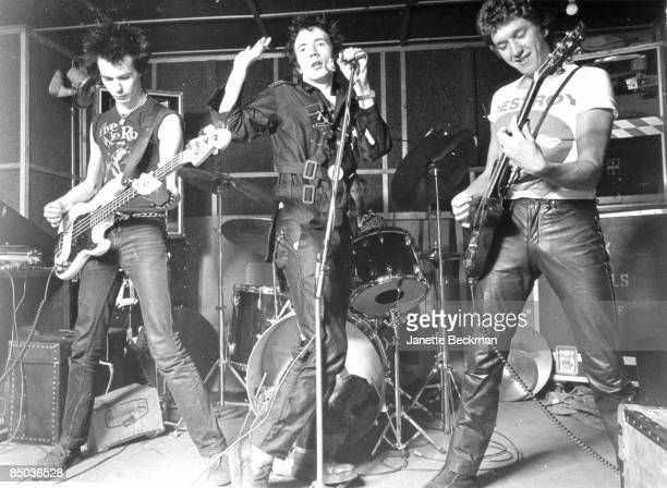 Photo of SEX PISTOLS LR Sid Vicious Johnny Rotten Steve Jones performing live