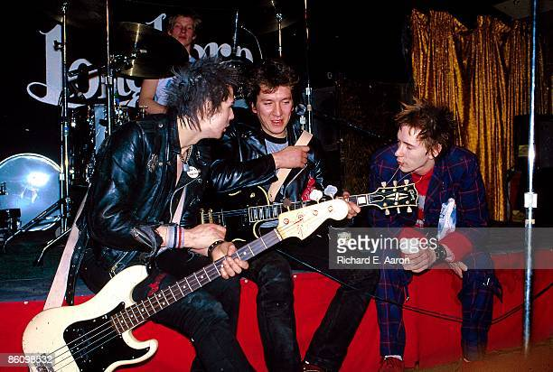 TEXAS Photo of SEX PISTOLS Paul Cook Front LR Sid Vicious Steve Jones Johnny Rotten posed group shot on stage at the Longhorn Ballroom Dallas during...