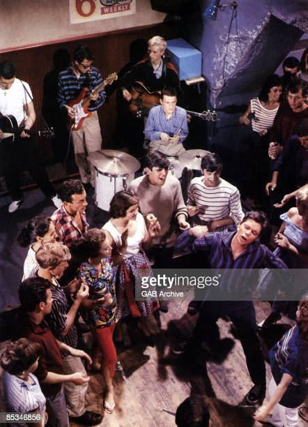 Photo of SHADOWS and Cliff RICHARD; with The Shadows in scene from the film 'Expresso Bongo'