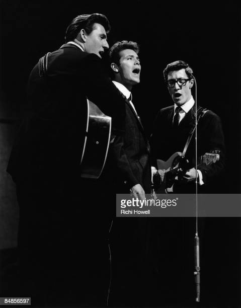 Photo of SHADOWS and Hank MARVIN and Bruce WELCH and Cliff RICHARD, with The Shadows - L-R: Bruce Welch, Cliff Richard, Hank Marvin - performing live...