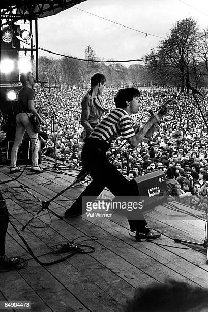 Photo of SHAM 69 and Joe STRUMMER and Jimmy PURSEY and CLASH and Paul SIMONON, L-R: Joe Strummer, Paul SImonon, Jimmy Pursey performing live onstage...