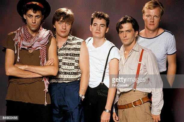 Photo of Simon CROWE and Bob GELDOF and BOOMTOWN RATS and Garry ROBERTS and Johnnie FINGERS and Pete BRIQUETTE Posed studio group portrait LR Bob...