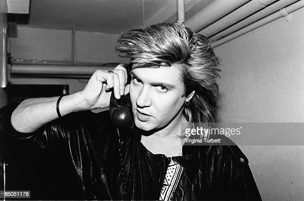 Photo of Simon LE BON and DURAN DURAN and Simon Le Bon and DURAN DURAN and LIVE EARTH CONCERT and Simon Le Bon Simon Le Bon posed on phone backstage...