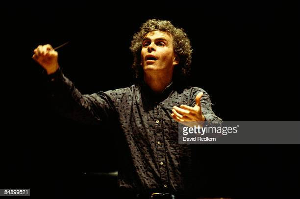 Photo of Simon RATTLE Conductor Simon Rattle performing on stage