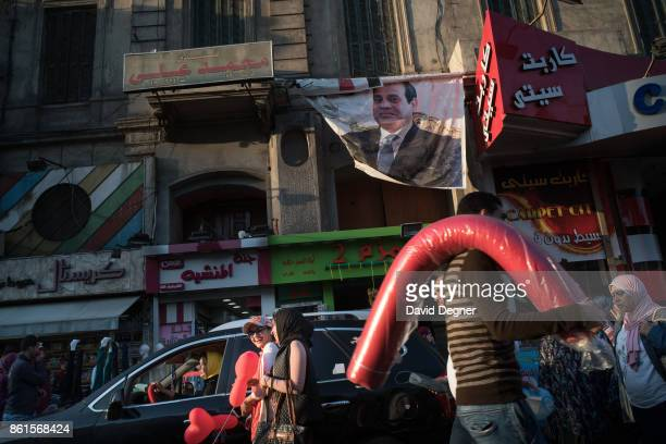 A photo of Sisi hangs above the street in central Alexandria during Holy Week on April 14 2017 in Alexandria Egypt