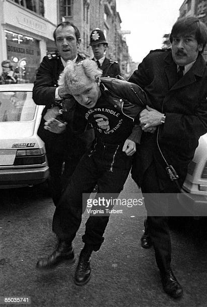 Photo of SKINHEADS and 80'S STYLE and 70'S STYLE and PUNKS Punk mourner arrested by police on the Sid Vicious memorial march