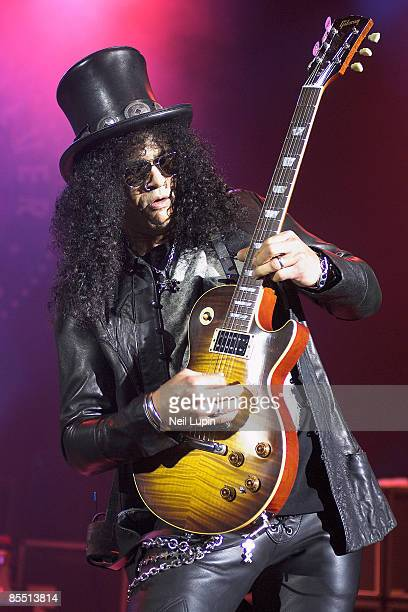 APOLLO Photo of SLASH and VELVET REVOLVER Slash performing live onstage wearing hat playing Gibson Les Paul guitar