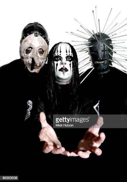 Photo of SLIPKNOT and Chris FEHN and Craig JONES and Joey JORDISON LR Chris Fehn Joey Jordison Craig 133 Jones posed studio