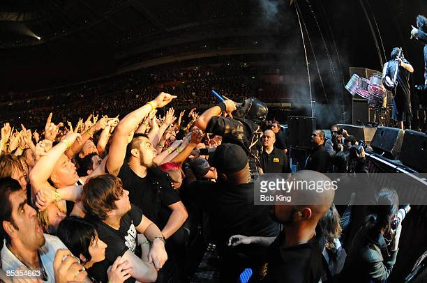 ARENA Photo of SLIPKNOT and Chris FEHN Chris Fehn performing on stage audience
