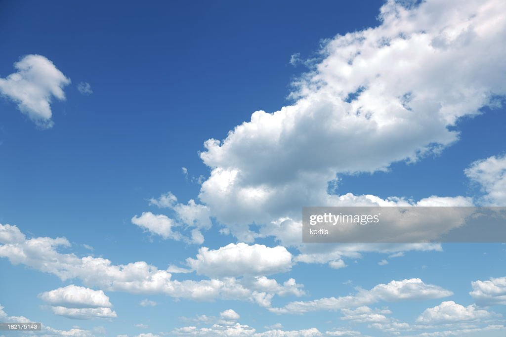 Photo of some white whispy clouds and blue sky cloudscape : Stock Photo