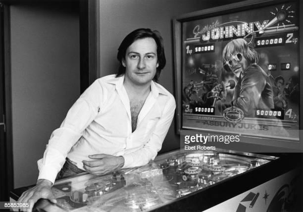Photo of SOUTHSIDE JOHNNY Posed portrait of John Lyon pinball machine