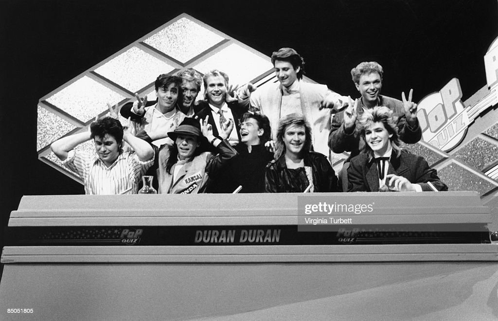 Photo of SPANDAU BALLET and DURAN DURAN; with Spandau Ballet, L-R: Roger Taylor, John Keeble, Martin Kemp (back), Andy Taylor, Steve Norman, John Taylor, Tony Hadley (back), Simon Le Bon, Martin Kemp (back), Nick Rhodes - recording Christmas Special of BBC 'Pop Quiz' TV show