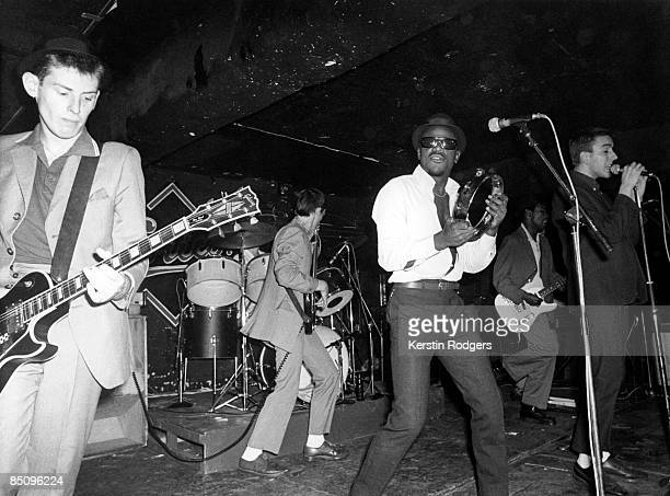 Photo of SPECIALS and Neville STAPLE and Terry HALL and Lynval GOLDING and Roddy RADIATION and Horace GENTLEMAN LR Roddy Radiation Horace Gentleman...
