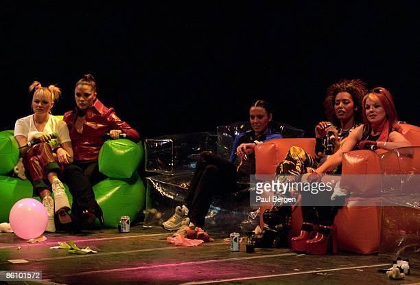 Photo of SPICE GIRLS Group on stage answering questions LR Emma Bunton Victoria Adams Melanie Chisholm Melanie Brown and Geri Halliwell