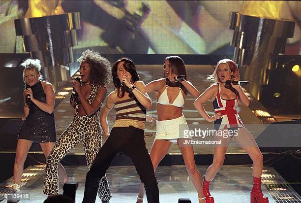 COURT Photo of SPICE GIRLS Group performing live on stage LR Emma Bunton Melanie Brown Melanie Chisholm Victoria Adams and Geri Halliwell Union Jack...