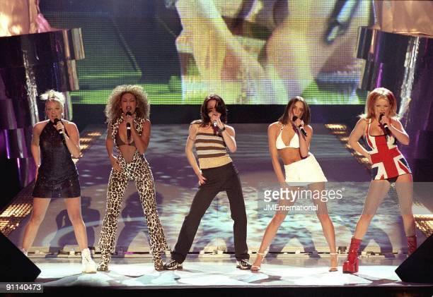 Photo of SPICE GIRLS, Group performing live on stage L-R Emma Bunton, Melanie Brown , Melanie Chisholm , Victoria Adams and Geri Halliwell, Union...