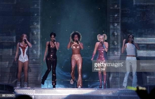 Photo of SPICE GIRLS Group performing live on stage LR Geri Hallliwell Victoria Adams Melanie Brown Emma Bunton and Melanie Chisholm