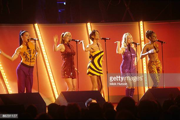 ARENA Photo of SPICE GIRLS Group performing live on stage LR Melanie Chisholm Geri Halliwell Victoria Adams Emma Bunton and Melanie Brown