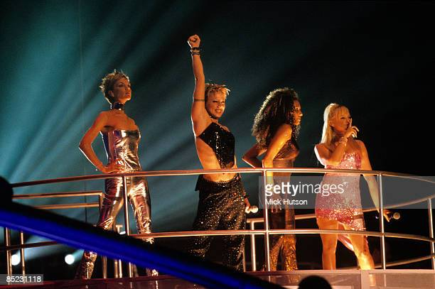 COURT Photo of SPICE GIRLS Group performing live on stage LR Victoria Beckham Melanie Chisholm Melanie Brown and Emma Bunton