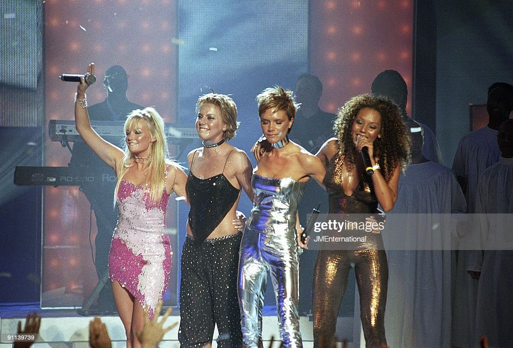 Emma Bunton, Melanie Chisholm (Mel C), Victoria Beckham and Melanie Brown (Mel B) performing live on stage