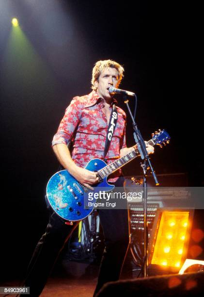 S BUSH EMPIRE Photo of Steve JONES and SEX PISTOLS Steve Jones performing live onstage on Flithy Lucre tour playing Gibson Les Paul guitar