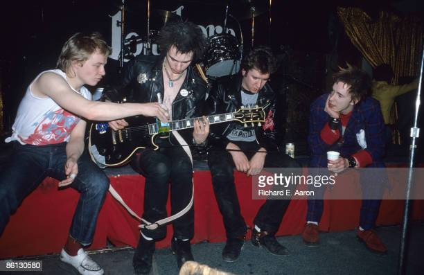 TEXAS Photo of Steve JONES and Sid VICIOUS and Paul COOK and SEX PISTOLS Paul Cook Sid Vicious Steve Jones Johnny Rotten posed group shot onstage at...