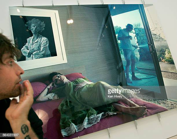 Photo of Steven Klein with his picture of Angelina Jolie and Brad Pitt on exhibit Profile of Steven Klein the fine art and fashion photographer who...