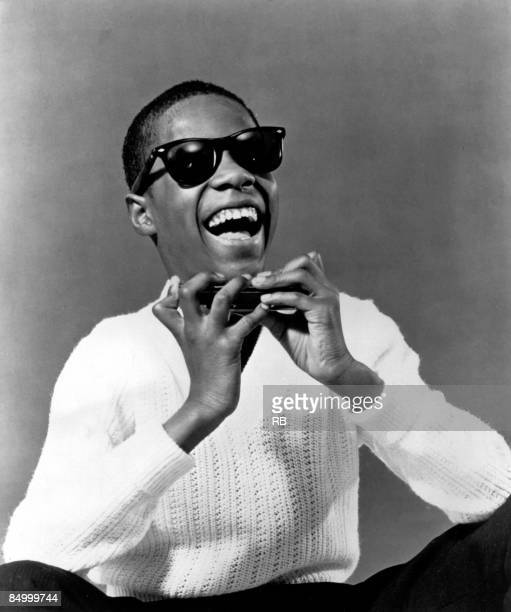 Photo of Stevie WONDER Posed portrait of Stevie Wonder with a harmonica early 1960's