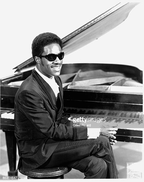 Photo of Stevie WONDER; Posed studio portrait of Stevie Wonder, sitting at piano