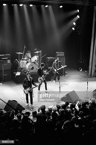 CLUB Photo of STIFF LITTLE FINGERS and Ali McMORDIE and Jake BURNS and Jim REILLY and Henry CLUNEY Group performing on stage LR Jake Burns Jim Reilly...