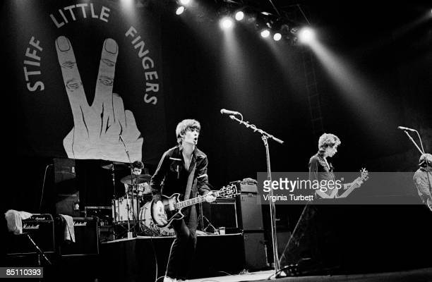ODEON Photo of STIFF LITTLE FINGERS and Jim REILLY and Jake BURNS and Ali McMORDIE and Henry CLUNEY Group performing on stage LR Jim Reilly Jake...