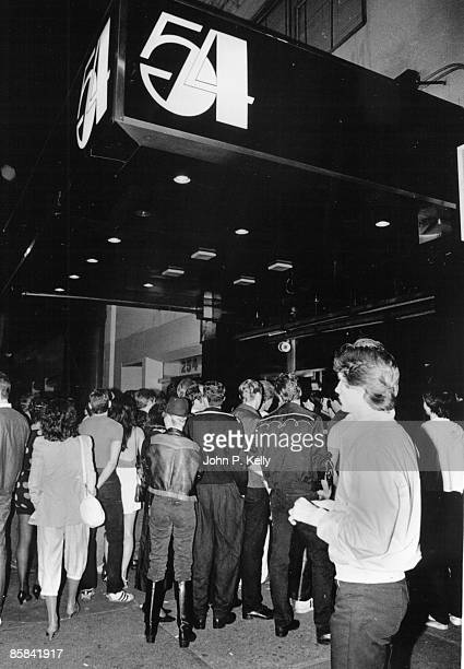 STUDIO 54 Photo of STUDIO 54 outside of club showing queue and name sign in New York circa 1975