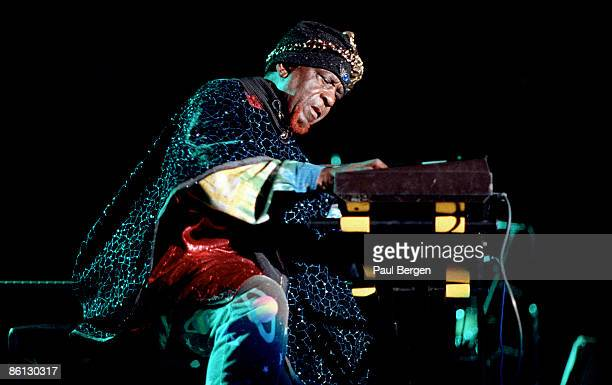 FESTIVAL Photo of SUN RA Playing keyboards live on stage