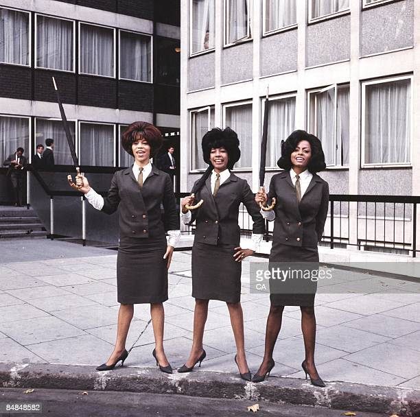 SQUARE Photo of SUPREMES and Florence BALLARD and Mary WILSON and Diana ROSS Posed full length group portrait outside Manchester Square Florence...