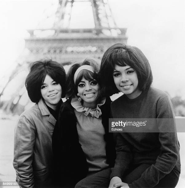 Photo of SUPREMES and Mary WILSON and Florence BALLARD and Diana ROSS Posed half length group shot Eiffel Tower blurred in background L R Florence...
