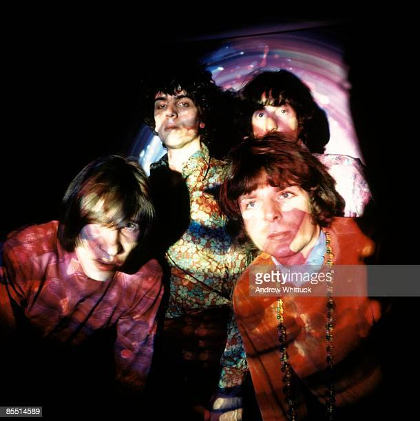 Photo of Syd BARRETT and PINK FLOYD Back LR Syd Barrett Nick Mason Front LR Roger Waters Rick Wright posed group shot psychedelic lighting