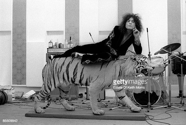 Photo of T REX and Marc BOLAN; filming 'Born To Boogie' at Ascot Sound Studios - the recording studio at John Lennon's Tittenhurst home. Posed, lying...