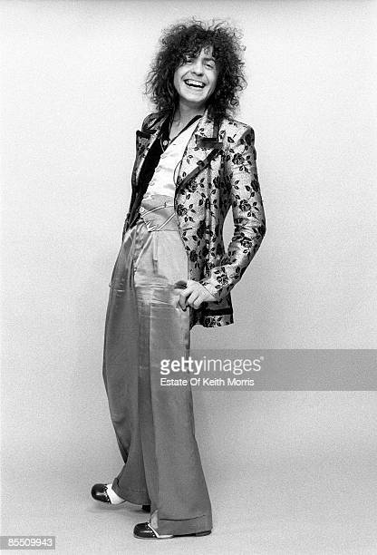 Photo of T REX and Marc BOLAN; Studio, posed. Full length shot, hands in pocket, wearing floral jacket and smiling