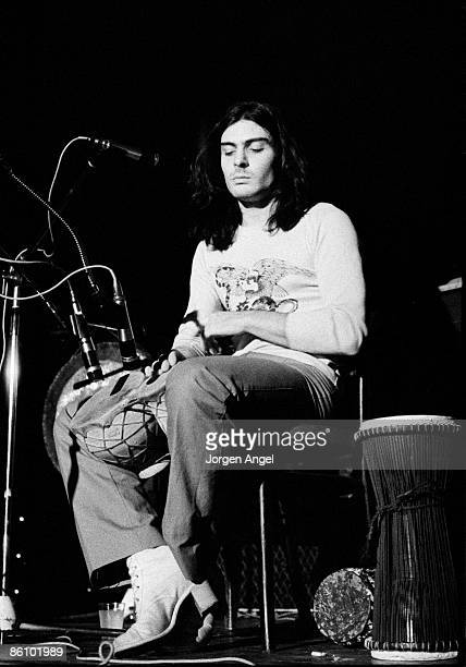 Photo of T REX and TYRANNOSAURUS REX and Mickey FINN; with Tyrannosaurus Rex , performing live onstage, playing bongos