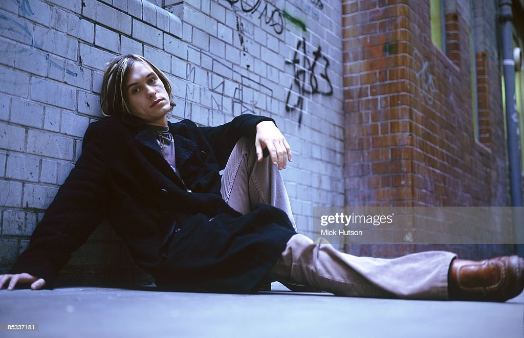Photo of TAKE THAT and Mark OWEN; Posed portrait of Mark Owen, sitting