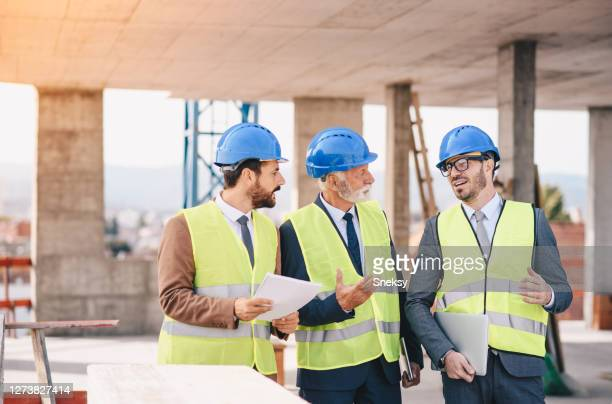 photo of teams engineer looking construction worker in a building site - constitution stock pictures, royalty-free photos & images