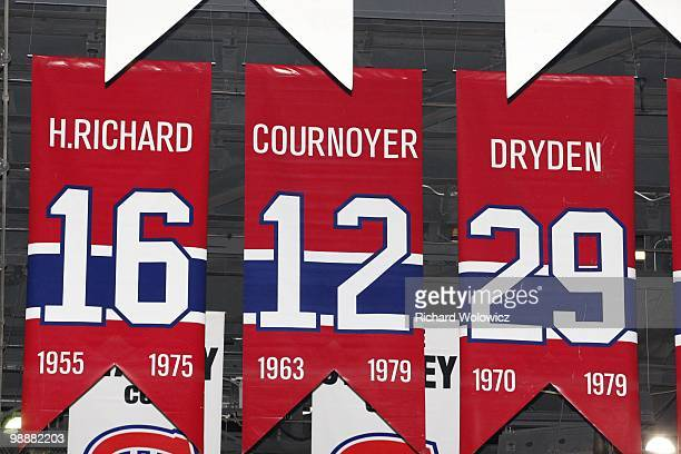 A photo of the banners commemorating the retired jerseys of Henri Richard Yvan Cournoyer and Ken Dryden hanging in the Bell Centre prior to Game...