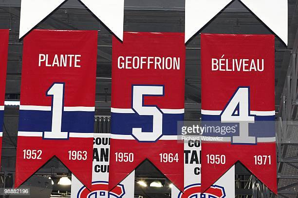 A photo of the banners commemorating the retired jerseys of Jacque Plante Bernard Geoffrion and Jean Beliveau hanging in the Bell Centre prior to...